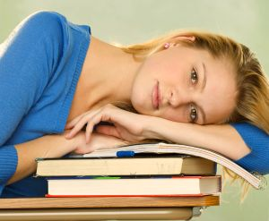 Inside Magic Image of Magic Student Resting on Great Magic Books