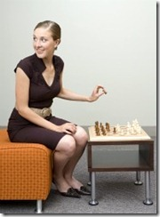 Woman Hiding Chess Piece for Magician